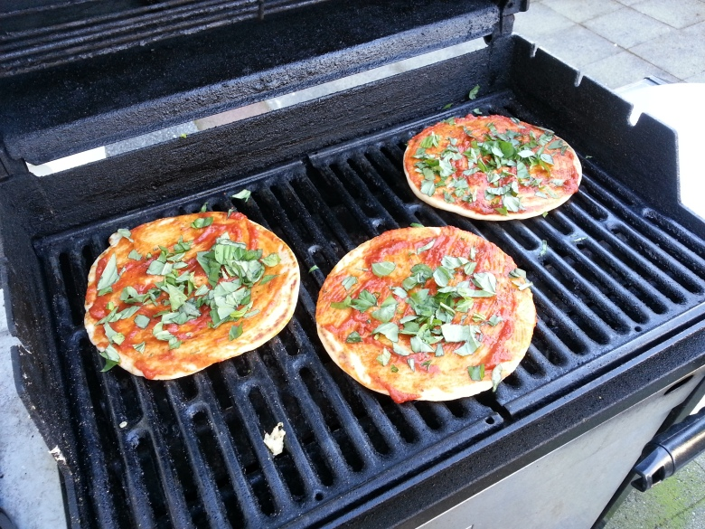 Pitas loaded with sauce and basil
