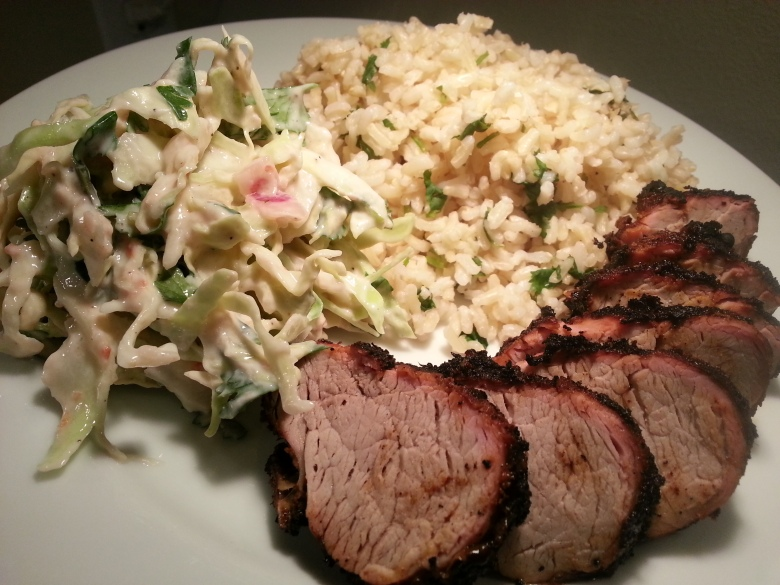 A nice, simple grilled pork alongside a gererous portion of rice and slaw
