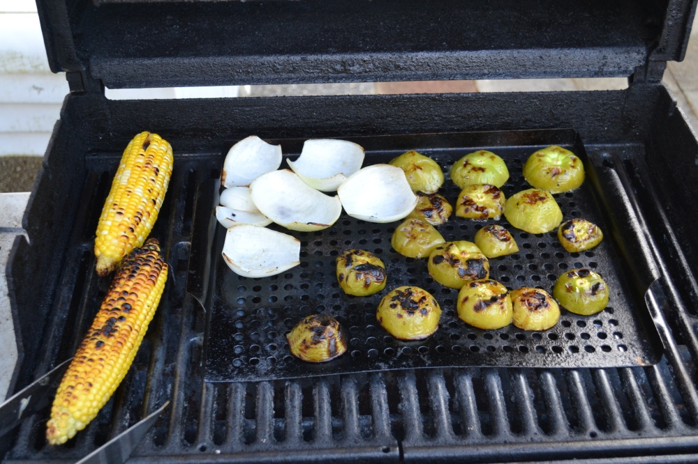 Grilling the onions, tomatillos, and some corn for a Jicama and grilled corn topping for the fish tacos