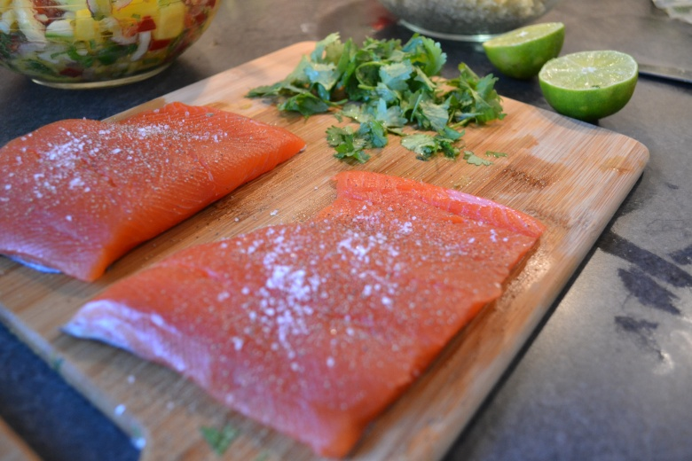 Seasoned salmon and some fresh produce